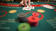 Blackjack dealer Rebecca Lehman at the St. Eugene Casino in Cranbrook which was a former residual school February 20, 2013. (John Lehmann/The Globe and Mail)