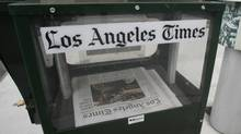 A Los Angeles Times newspaper vending box is shown in front of the Times building in Los Angeles, Calif. (FRED PROUSER/REUTERS)