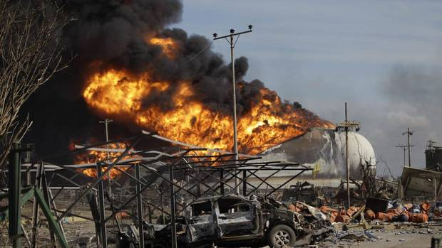 Storage tanks were still ablaze Monday after a gas leak caused a massive explosion early Saturday at the Amuay refinery in Paraguana, Venezuela's biggest refinery. More than 40 people were killed in one of the worst accidents to hit the global oil industry in decades. (Ariana Cubillos/AP)