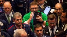 Traders work on the floor of the New York Stock Exchange (NYSE) on Friday, Sept. 23. (Michael Nagle/Bloomberg)
