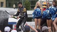 Canadian Driver James Hinchcliffe sprays champagne as he celebrates his third place finish in the Honda Indy Toronto, in Toronto, on Sunday, July 17, 2016. (Chris Young/The Canadian Press)