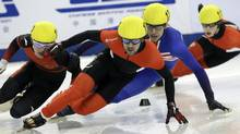 Canada's Charles Hamelin, centre, leads other skaters during the men's 500-meter final at the ISU World Cup short track speed skating competition at Oriental Sports Center in Shanghai, China, on Sunday, Dec. 11, 2011.  Hamelin finished in a time of 40.905 seconds. (Associated Press)
