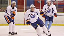 Edmonton Oilers Eric Belanger ,left, Corey Potter ,centre, and Ladislav Smid skate during the Oilers first practice after the NHL lockout, in Edmonton, Alta., on Monday January 7, 2013. (JASON FRANSON/THE CANADIAN PRESS)