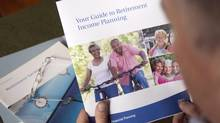 A man looks at a retirement planning brochure in Montreal. Two of the largest RRSP contribution declines were in 2008 and 2009. (Ryan Remiorz/THE CANADIAN PRESS)