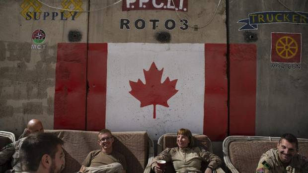 Canadian troops swap tales over coffee in their lounge at Camp Souter, just north of Kabul. The soldiers now have less than five months before being fully withdrawn from Afghanistan. (Kiana Hayeri For The Globe and Mail)