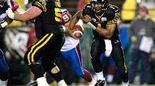 Hamilton Tiger-Cats quarterback Henry Burris runs the ball during first half CFL action against the Montreal Alouettes at Ivor Wynne Stadium in Hamilton, Ont., on Friday, September 28, 2012. (Geoff Robins/THE CANADIAN PRESS)