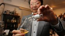 Hideo Yamaoka pours the last drop from a rare 1910 Ainslie's whisky. According to the Investment Grade Scotch index, the top 100 single malts delivered an average return of 440 per cent from the start of 2008 till the end of July this year. (Nathan Vander Klippe/The Globe and Mail)