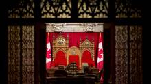 The thrones in the Senate Chamber are seen through the main entrance on Parliament Hill Wednesday May 22, 2013 in Ottawa. (Adrian Wyld/THE CANADIAN PRESS)