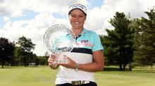 Brooke Henderson poses with the championship trophy during the final round of the Meijer LPGA Classic at Blythefield Country Club on June 18, 2017 in Grand Rapids, Michigan. (Stacy Revere/Getty Images)