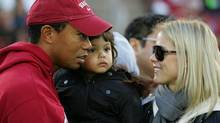 Tiger Woods holds his daugher, Sam, and speaks to his wife, Elin Nordegren, on the sidelines before a Stanford Cardinal football game at Stanford Stadium on November 21. Woods was reported to be in a car accident Friday. (Ezra Shaw/Ezra Shaw/Getty Images)
