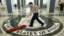 FILE - A workman quickly slides a dustmop over the floor at the Central Intelligence Agency headquarters in Langley, Va., near Washington, in this March 3, 2005 file photo. (AP Photo/J. Scott Applewhite, File) (J. SCOTT APPLEWHITE/AP)
