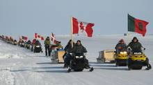 An April 2010 file photo shows Defence Minister Peter McKay and Chief of Defence Staff Gen. Walter Natynczyk leading a parade of Canadian Rangers and regular-force soldiers up the runway of a remote military post on the northern tip of Ellesmere Island at the close of Operation Nunalivut, a military mission intended to reinforce Canada's control of the North. The operation included the participation of a Danish military sled dog team, the first time foreign personnel have taken part in such an operation. (Bob Weber/THE CANADIAN PRESS)