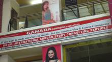 A sign for Royal International Abroad Study Consulting Services in Jaipur.