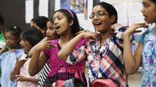 Nuradi Dahanaggamaarachchi, 12, takes part in a traditional performance with her classmates at a Sinhalese class in Brampton, Ontario which is one of 23 languages being taught in publicly-funded classes across the Peel District School Board on Saturday, May 25, 2013. (Michelle Siu/The Globe and Mail)