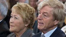 Quebec Premier Pauline Marois and her husband Claude Blanchet attend a memorial service for the victims of the July 6 train derailment that killed an estimated 47 people Saturday, July 27, 2013 in Lac-Megantic, Que. Mr. Blanchet said, in a statement Feb. 14, 2014, that Quebec's opposition parties are conducting a malicious and defamatory campaign against him and Ms. Marois. (Paul Chiasson/THE CANADIAN PRESS)
