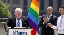 Toronto Mayor Rob Ford reads a declaration while participating in the official flag raising of Toronto Pride week June 24, 2013. (Moe Doiron/The Globe and Mail)