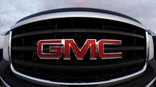 A GMC logo is seen on a pickup truck at the Laurier General Motors dealership in Quebec City, May 31, 2009. (MATHIEU BELANGER/REUTERS)