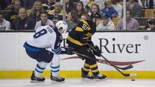 Winnipeg Jets defenceman Jacob Trouba (8) and Boston Bruins centre Ryan Spooner (51) battle for the puck during the second period at TD Garden in Boston on Nov. 19, 2016. (Gregory Fisher/USA Today Sports)