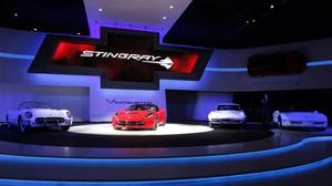 The 2014 Chevrolet Corvette Stingray, second from left, is shown at media previews for the North American International Auto Show in Detroit, Monday, Jan. 14, 2013. (AP Photo/Paul Sancya)