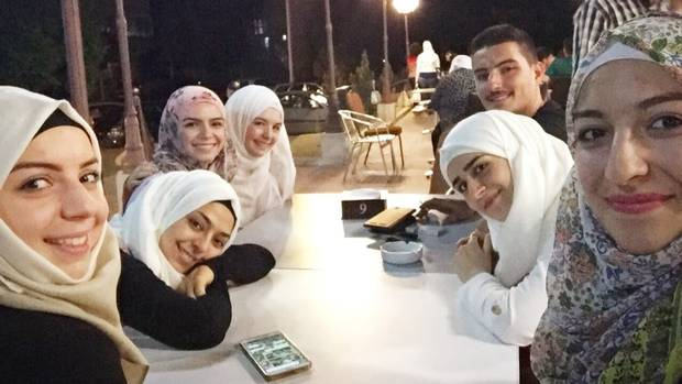 Bushra Nassab, third from left, visits with her cousins in Syria. While her family welcomed her warmly, Nassab says it was clear the war had taken a toll on them.