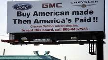 A 'Buy American Made' billboard promoting American made vehicles is seen along a business district in Taylor, Michigan June 9, 2009. (REBECCA COOK)