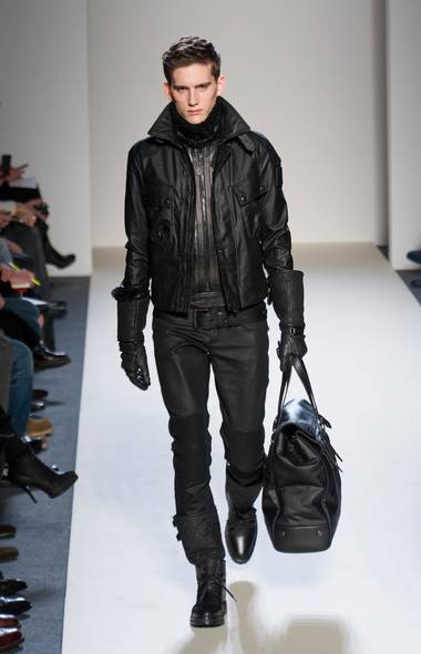 A black leather jacket is a casual classic, but this season, the slickest models have two features in common: They hit at the belt line and they have knit