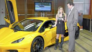 Car show model and A-Channel interviewer Amanda Lee at the Canadian International Auto Show. Behind her is the HTT Plethore, a Quebec-built supercar. To the right is Sebastien Forest, CEO and co-owner of HTT. Car show model and A-Channel interviewer Amanda Lee at the Canadian International Auto Show. Behind her is the HTT Plethore, a Quebec-built supercar. To the right is Sebastien Forest, CEO and co-owner of HTT.