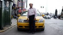 Dasalakis Theodoros, 60, says he and his son share a taxi so they can work 24 hours a day to make ends meet. (Cathal McNaughton/Reuters/Cathal McNaughton/Reuters)