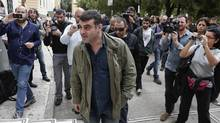 Greek editor Costas Vaxevanis arrives at a court in Athens. (YORGOS KARAHALIS/REUTERS)