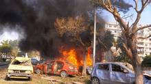 This photo released by the Syrian official news agency SANA, shows flames and smoke rising from burned cars after a huge explosion that shook central Damascus on Thursday, Feb. 21, 2013. A car bomb shook central Damascus on Thursday, exploding near the headquarters of the ruling Baath party and the Russian Embassy, eyewitnesses and opposition activists said. (SANA/Associated Press)