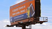 A billboard calling on the NFL to stop punishing players for using marijuana is shown in front of Sports Authority Field in Denver. (Ed Andrieski/AP)