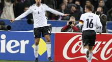 Germany's Sami Khedira celebrates after scoring against France during their international friendly soccer match at the Stade de France stadium in Saint-Denis, near Paris, February 6, 2013. (CHARLES PLATIAU/REUTERS)