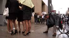 """Bill Cunningham at work in a scene from """"Bill Cunningham New York."""" (First Thought Films)"""