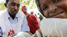 National workers with MSF conduct a screening and measles vaccination clinic inside a section of the large Tarabunka camp for displaced persons in Mogadishu, Somalia on Sept. 8, 2011. (Peter Power/The Globe and Mail)