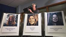 Portraits of one and possibly two other murdered women are displayed during an RCMP news conference  in Surrey, B.C., on Sept. 25, 2012. (Andy Clark/REUTERS)
