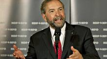 Deputy NDP leader Thomas Mulcair takes questions at a caucus meeting in Quebec City on Sept. 13, 2011. (Jacques Boissinot/THE CANADIAN PRESS)