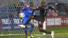 Toronto FC midfielder Jackson Goncalves kicks a goal against Chicago Fire goalkeeper Sean Johnson (Mike Dinovo/USA Today Sports)