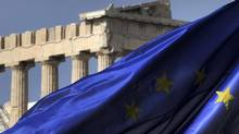 Columns of the Parthenon temple are seen behind an EU flag in Athens on Novemebr 4, 2011. (Getty)