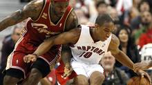 Toronto Raptors forward Demar DeRozan protects the ball against Cleveland Cavaliers forward LeBron James (L) during the first half of their NBA basketball game in Toronto February 26, 2010. REUTERS/ Mike Cassese (MIKE CASSESE)
