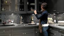 This slate-grey wet bar is just steps from an elegant and well-lit dining room. The dark palette marks it as a service room separate from the more formal dining and entertaining areas. (Barry Calhoun/Barry Calhoun)