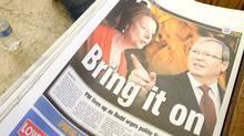 An Australian newspaper covers the political battle between Australian Prime Minister Julia Gillard, left, and former foreign minister Kevin Rudd, on Feb. 23, 2012. (Rick Rycroft/AP/Rick Rycroft/AP)