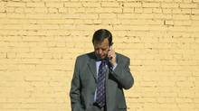 A man makes a call on a mobile phone. (Unspecified)