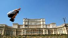 The author joins the Hash House Harriers of Bucharest to run about exploring the city, including the Palace of the Parliament, once the world's largest building. (Robin Esrock/Robin Esrock)