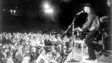 Stompin' Tom Connors in concert at the Forum at Ontario Place in Toronto, Aug. 4, 1974. (John McNeill/The Globe and Mail)