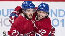 Montreal Canadiens' Alex Galchenyuk (27 celebrates with teammate Sven Andrighetto (42) after scoring against the Dallas Stars during second period NHL hockey action in Montreal, Tuesday, March 8, 2016. (Graham Hughes/THE CANADIAN PRESS)