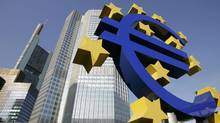 A picture taken 28 June 2005 shows a giant Euro symbol, the currency of the EU, standing in front of Frankfurt's Eurotower, which houses the European Central Bank (ECB). (John MacDougall/AFP/Getty Images/John MacDougall/AFP/Getty Images)
