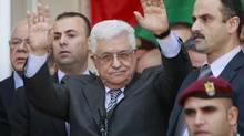 Palestinian President Mahmoud Abbas waves to the crowd during a rally supporting the Palestinian UN bid for observer state status, in the West Bank city of Ramallah, Sunday, Nov. 25, 2012. The Palestinians will request to upgrade their status on November 29. The status could add weight to Palestinian claims for a state in the West Bank, Gaza Strip and east Jerusalem, territories captured by Israel in the 1967 Mideast war from Jordan. (Majdi Mohammed/AP)