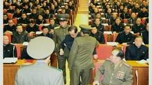 A still image taken from North Korea's state-run KRT television footage shows Jang Song Thaek being forcibly removed by uniformed personnel from a meeting of the Political Bureau of the Central Committee of the Workers' Party of Korea in Pyongyang. (Yonhap/Reuters)