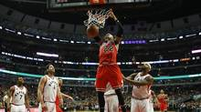 Chicago Bulls forward Taj Gibson (22) dunks the ball against the Toronto Raptors during the second half at United Center. (Kamil Krzaczynski/USA Today Sports)