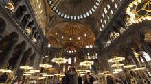A couple takes pictures as they visit the Byzantine monument of Hagia Sophia in Istanbul May 25, 2011. (MURAD SEZER/MURAD SEZER/REUTERS)